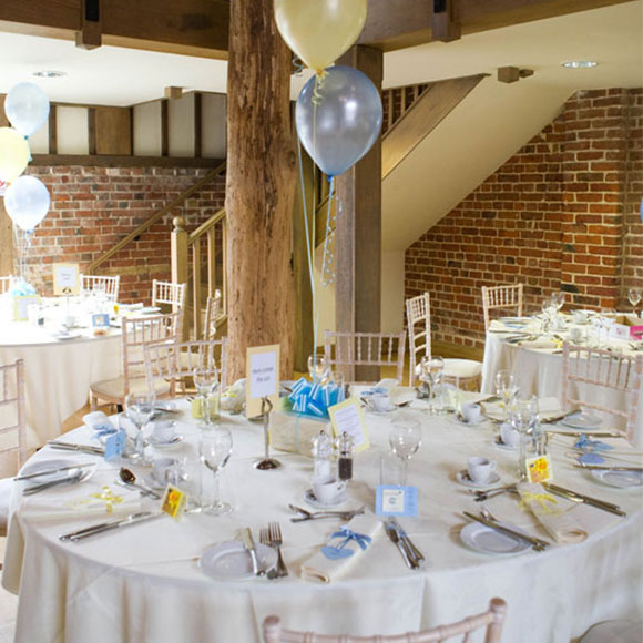 Cream Yellow And Blue Table Decorations For A Reception Wedding