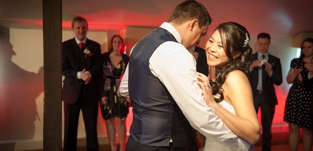 Bride and groom enjoying their first dance – barn hire Essex