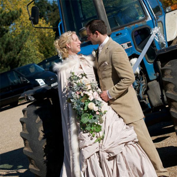 The groom arrived on his favourite blue tractor to the wedding