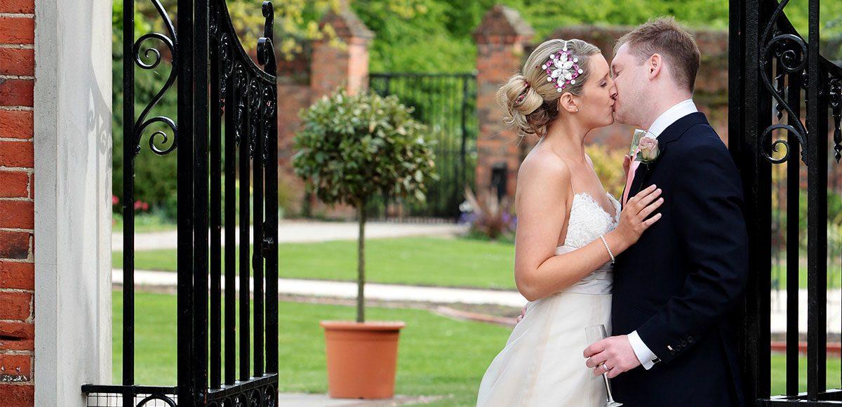 Bride and groom in the gardens of Gaynes Park wedding venue.