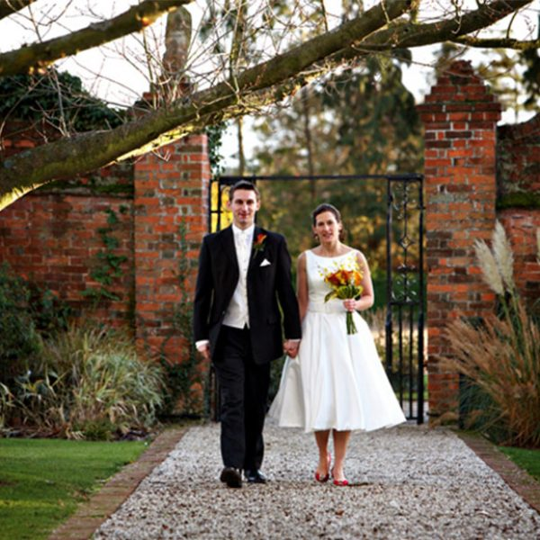 The happy couple enjoying a quiet moment together after their civil ceremony at Gaynes Park