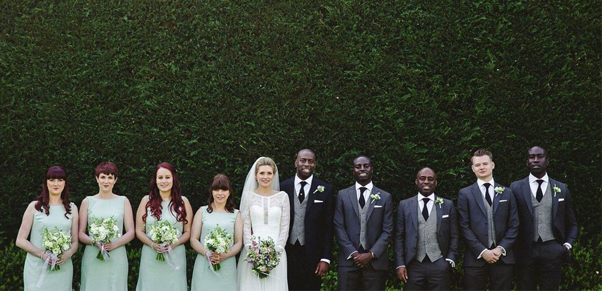 Wedding party posing in the gardens of an Essex wedding venue