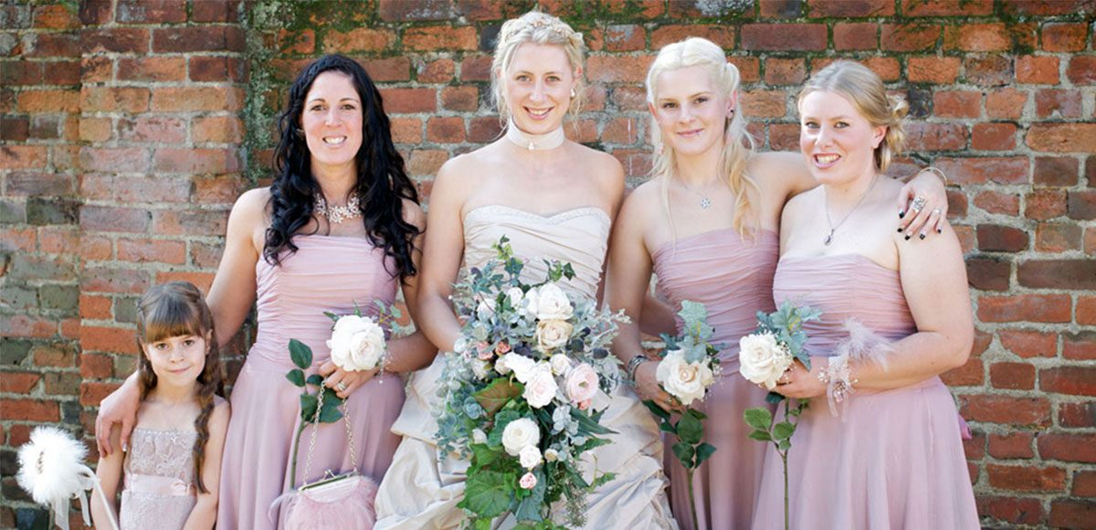 The bridesmaids wore strapless pink chiffon dresses from Monsoon