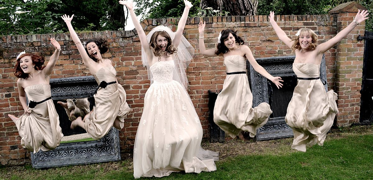 The Bridesmaids wore Champagne coloured strapless dresses from Coast with a black detail belt