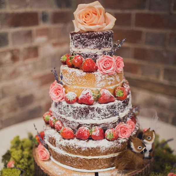 Pretty naked cake ready for a Gaynes Park wedding reception