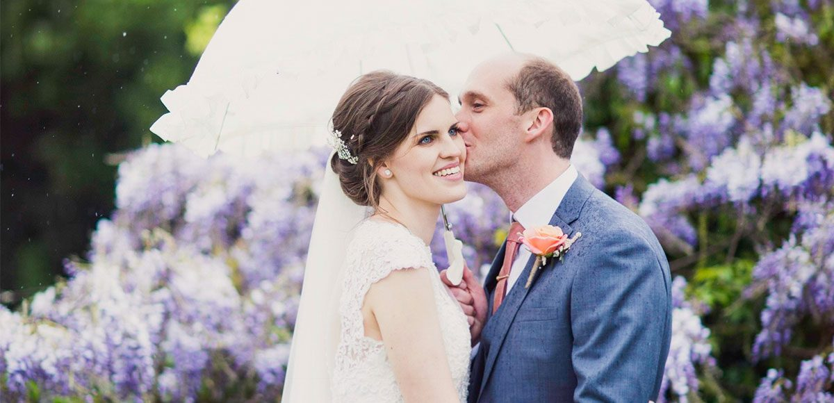 Bride and groom enjoying the gardens of Gaynes Park during their Spring wedding