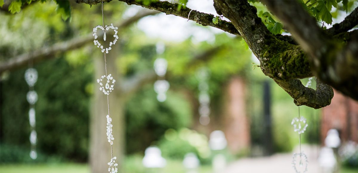 Trees covered in wedding decorations for an Essex wedding ceremony