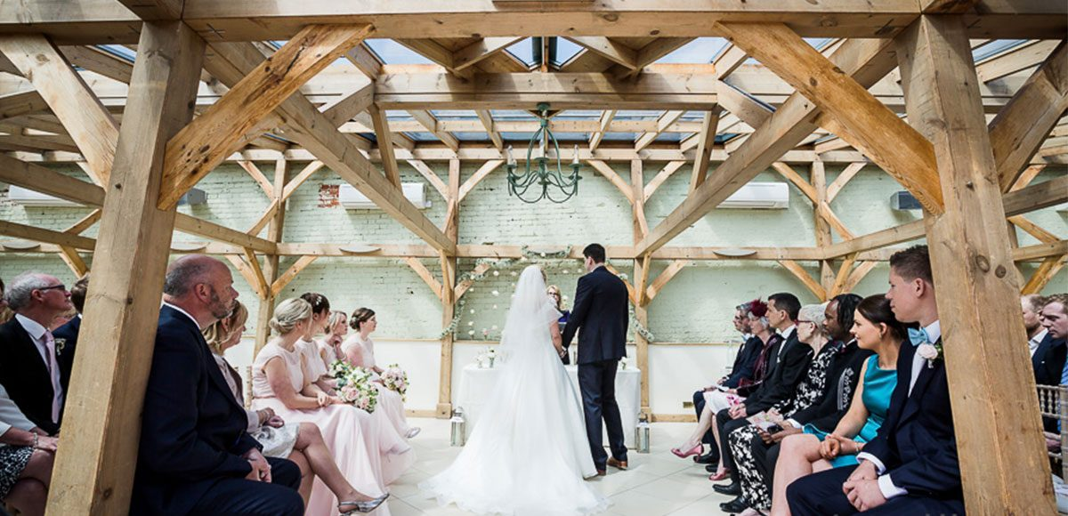 Bride and groom during their wedding ceremony – Essex wedding venues