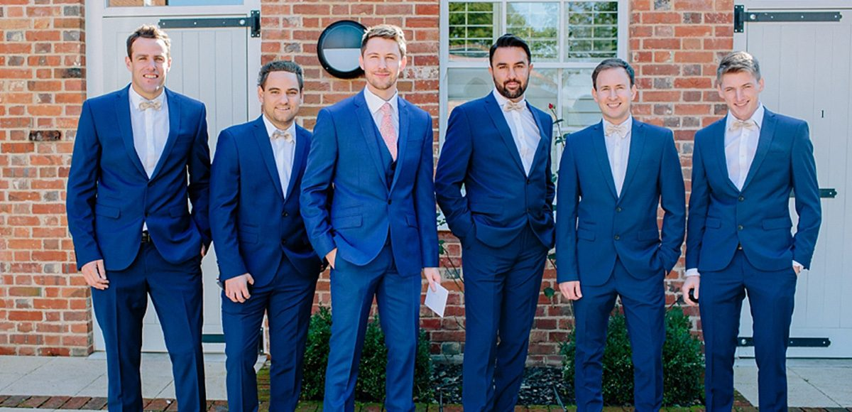 Blue wedding suits for the groom and groomsmen