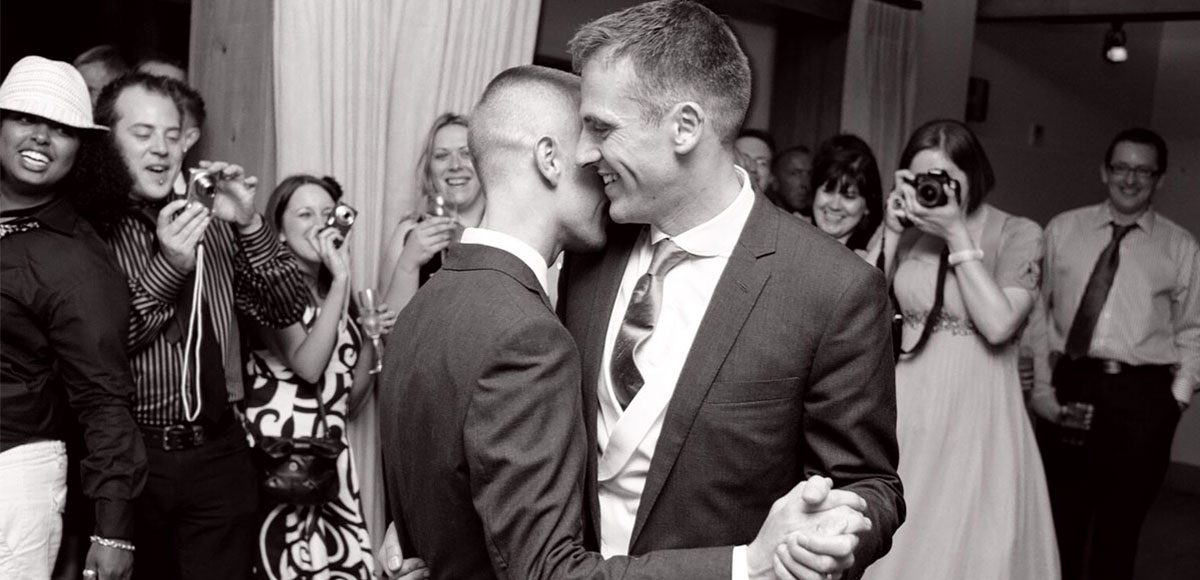 Grooms enjoying their first dance at Gaynes Park wedding venue