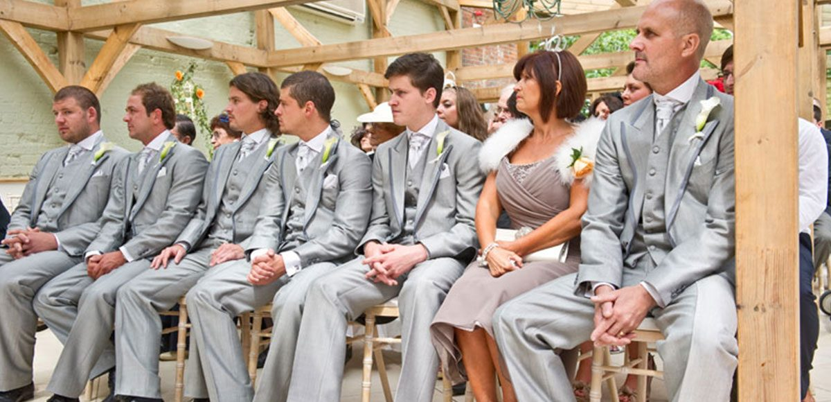 Groomsmen sat watching the ceremony in the Orangery – Essex wedding venues