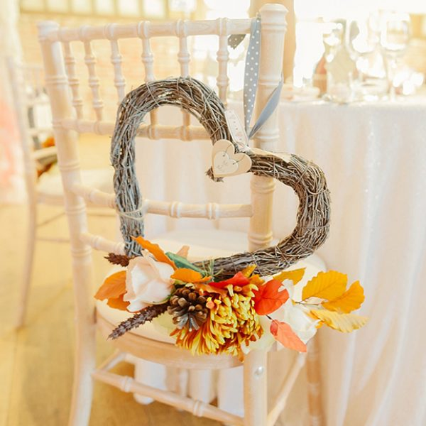 A wicker heart decoration for a rustic wedding