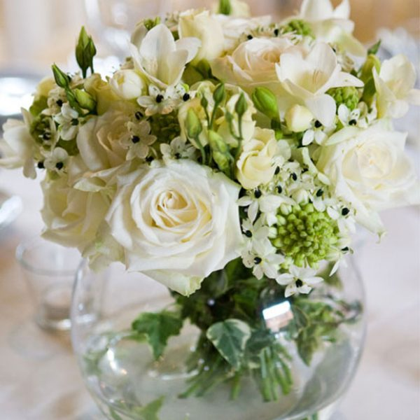Ivory flowers as a table centrepiece for the wedding reception – barn wedding venue Essex