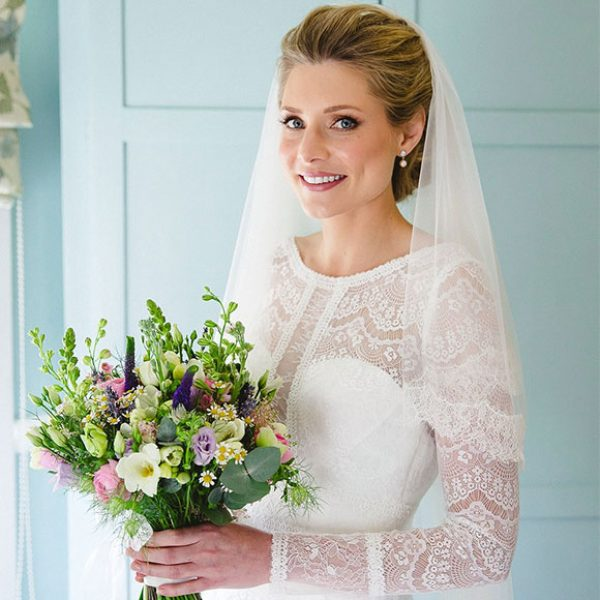 Bride with lace dress and Spring wedding bouquet ready for her Gaynes Park wedding