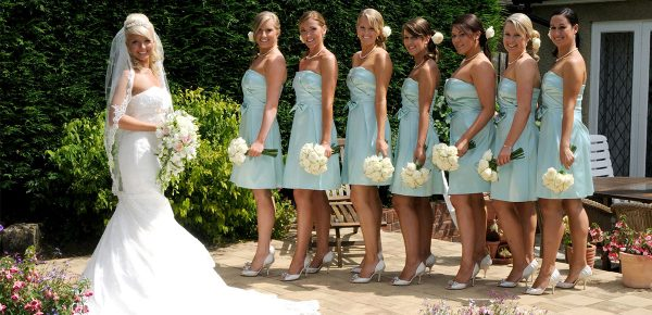 Bridesmaids in summer dresses with the bride