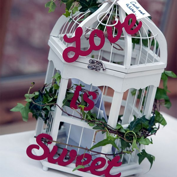 Birdcage decorated to hold wedding cards