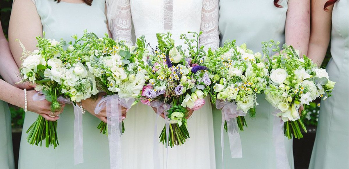 Mint green bridesmaids dresses and spring bouquets for a Gaynes Park wedding