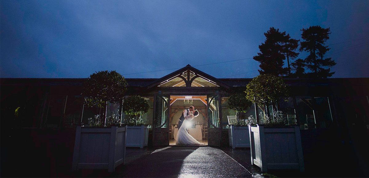Gaynes Park's beautiful Orangery lit up at night after a wedding