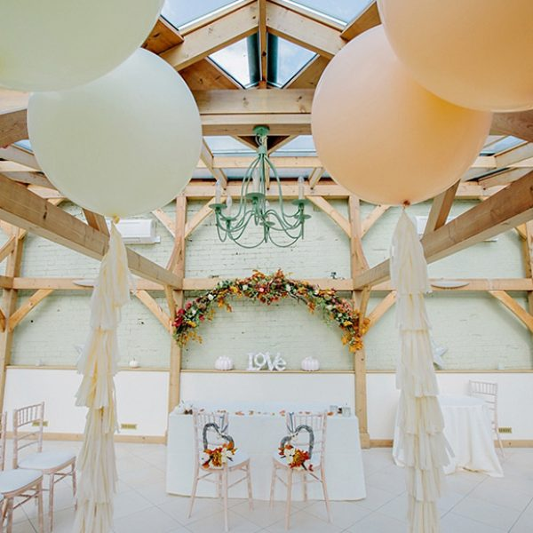 The Orangery at Gaynes Park decorated with blush coloured oversized wedding balloons