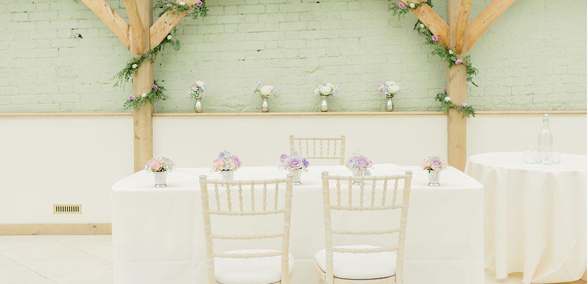 Elegant wedding decorations for an Orangery wedding ceremony at Gaynes Park – wedding venues Essex