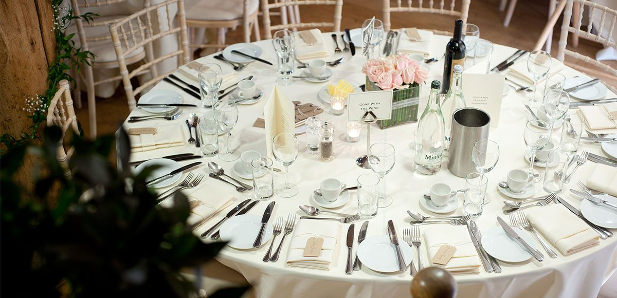 Table set up for a barn wedding at Gaynes Park – barn wedding venues