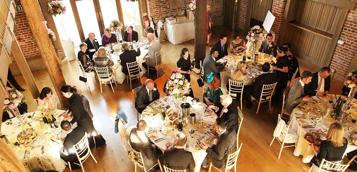 Wedding guests enjoying the reception at Gaynes Park – wedding barns Essex