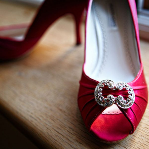 The bride wore scarlet red wedding shoes adding a fun touch to her wedding