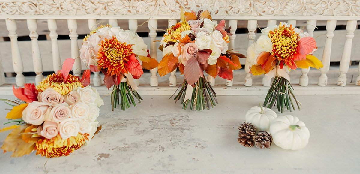 Bridal bouquets of orange, blush and cream wedding flowers