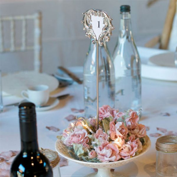Delicate rose petals were used as the decorative touches for the wedding reception centrepieces