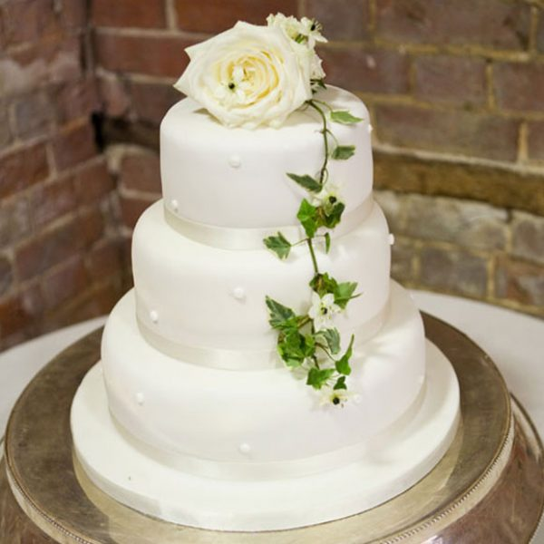 Simple white wedding cake for wedding guests to enjoy