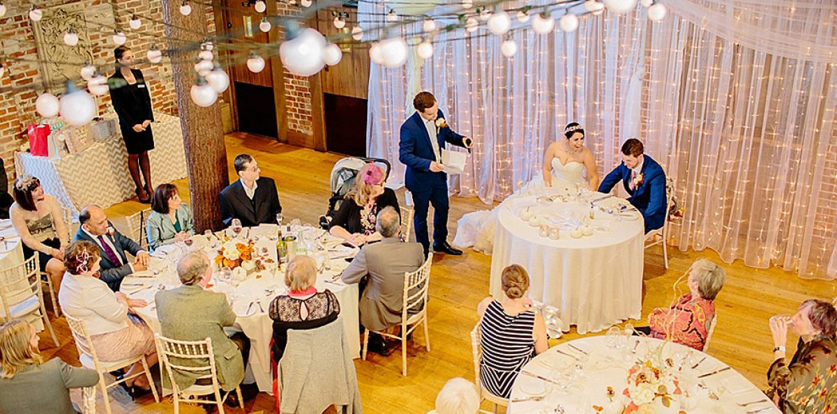 The bride and groom sat at a sweetheart table for their wedding reception