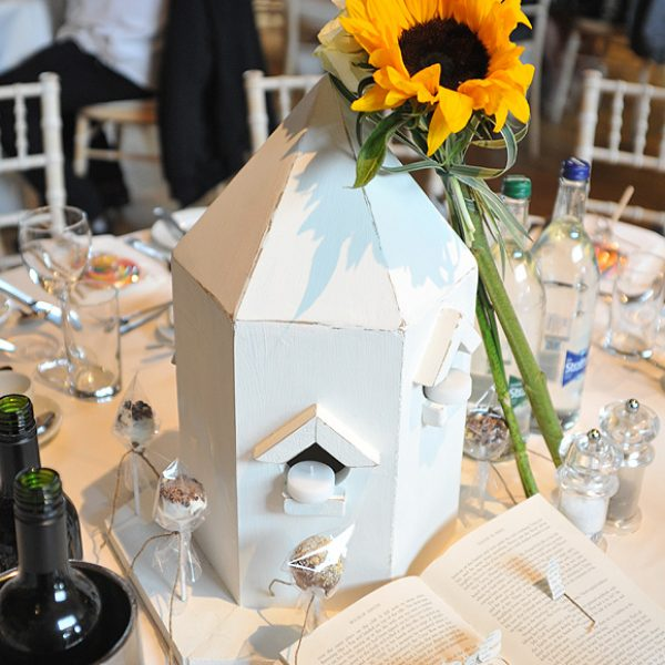 A white birdbox wedding table centrepiece