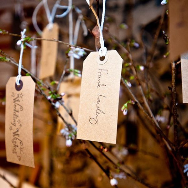 Tree used as wedding guestbook for a barn wedding reception