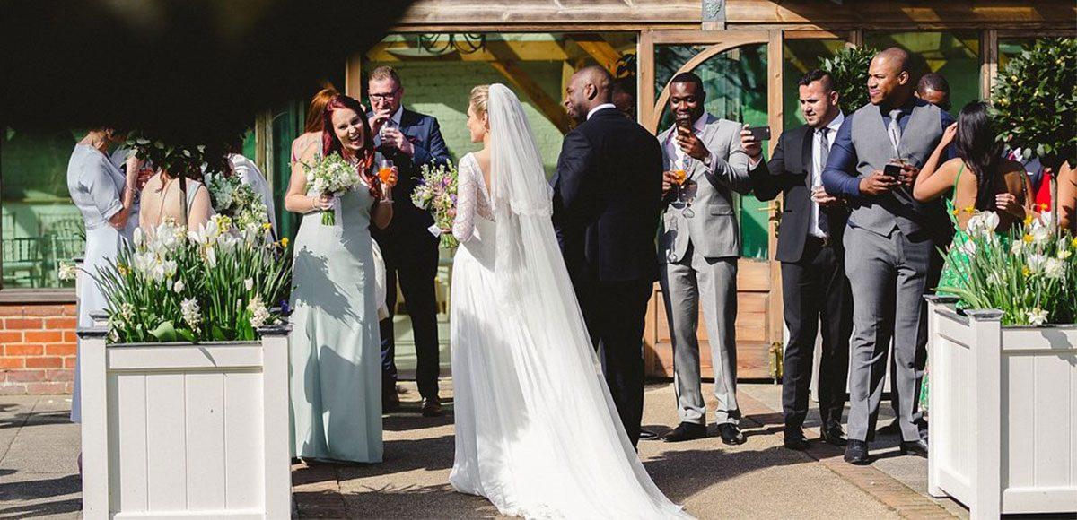 Wedding guests enjoy the drinks reception at Gaynes Park