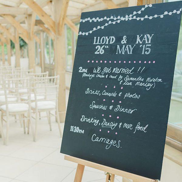 Chalkboard sign in the Orangery of Gaynes Park - wedding venues in Essex