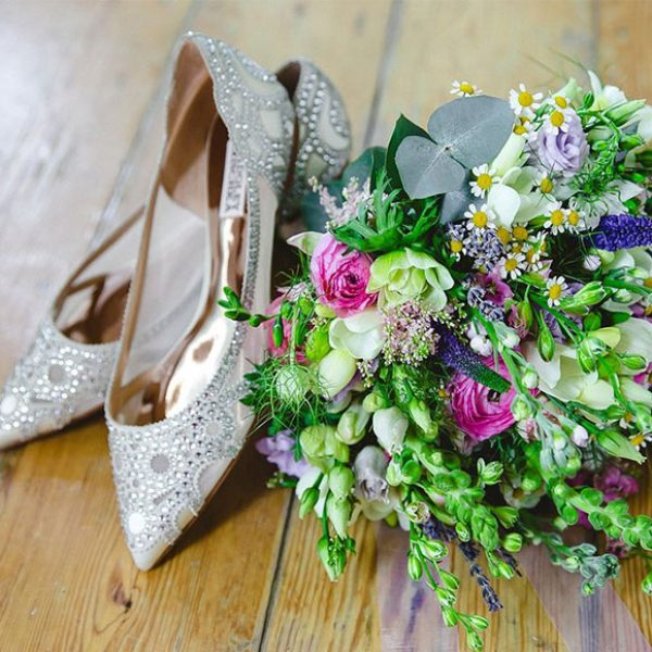 Glittery wedding shoes and Spring wildflower bouquet