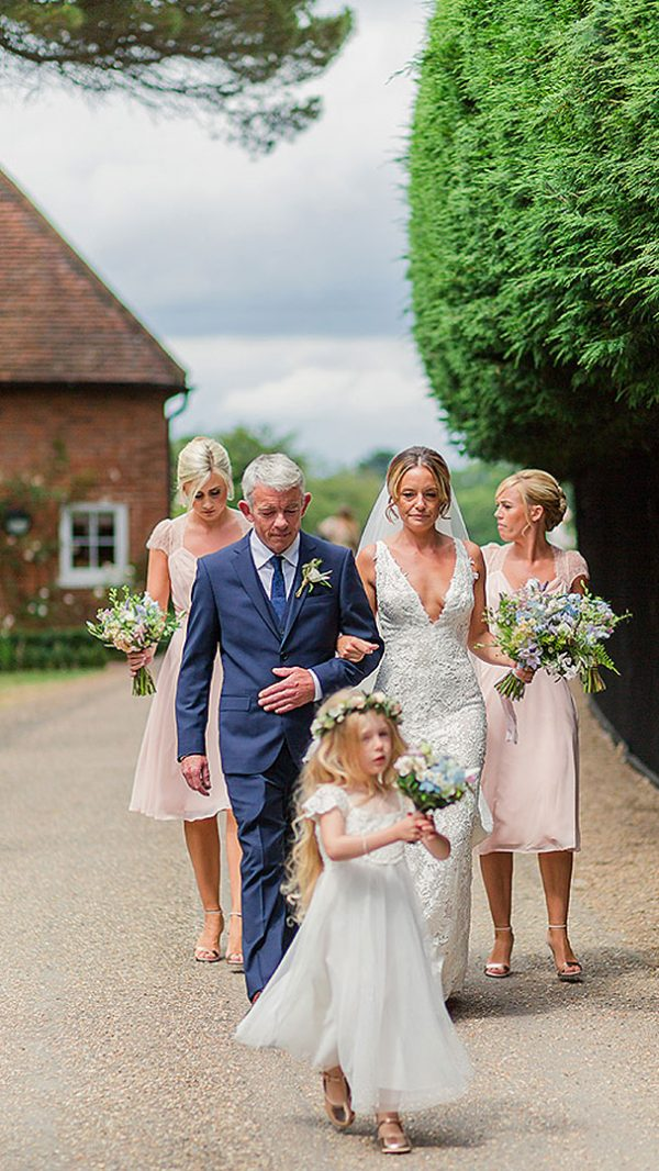 A bride and her bridesmaids leave the Apple Loft Cottage - wedding venues in Essex