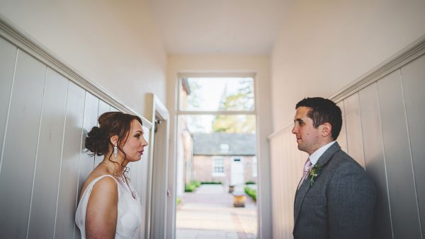 A bride and groom stand together inside the wedding accommodation - essex wedding venue