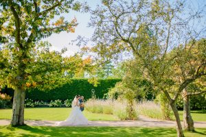 Walk down the most incredible aisle through the autumn gardens at one of the finest wedding venues in Essex
