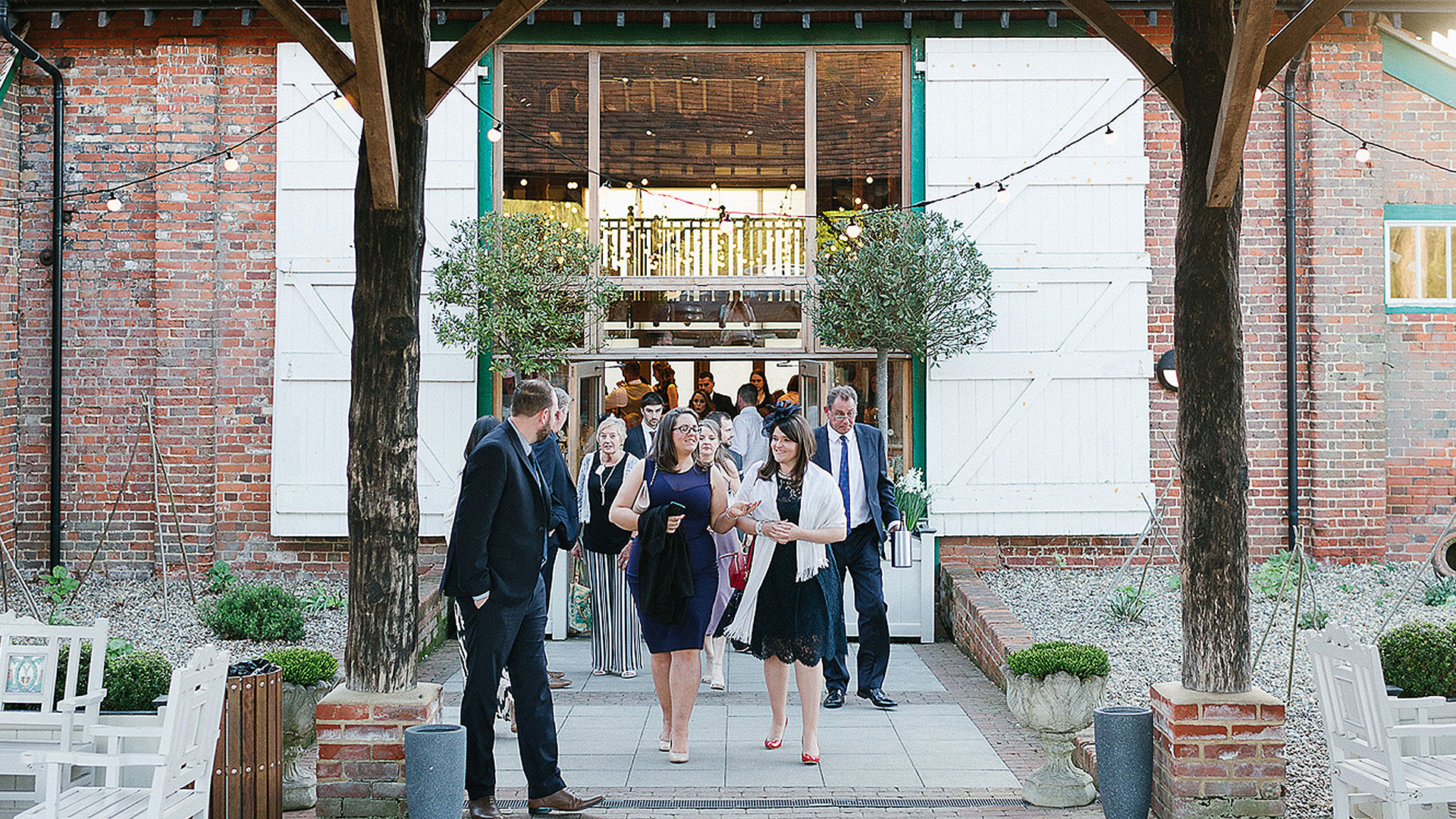 Guests leave the Mill Barn wedding barn in Essex - wedding reception venue