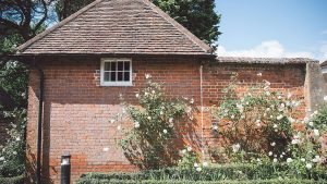 Surrounded by beautiful white roses the Apple Loft Cottage is the perfect retreat for the honeymoon couple