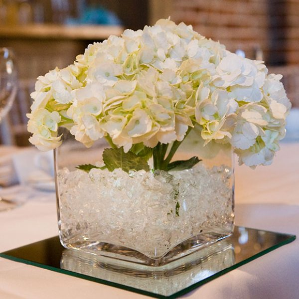 White flowers as a table centrepiece – barn hire Essex