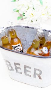 Present cold beers in metal containers to add a rustic look to your summer wedding