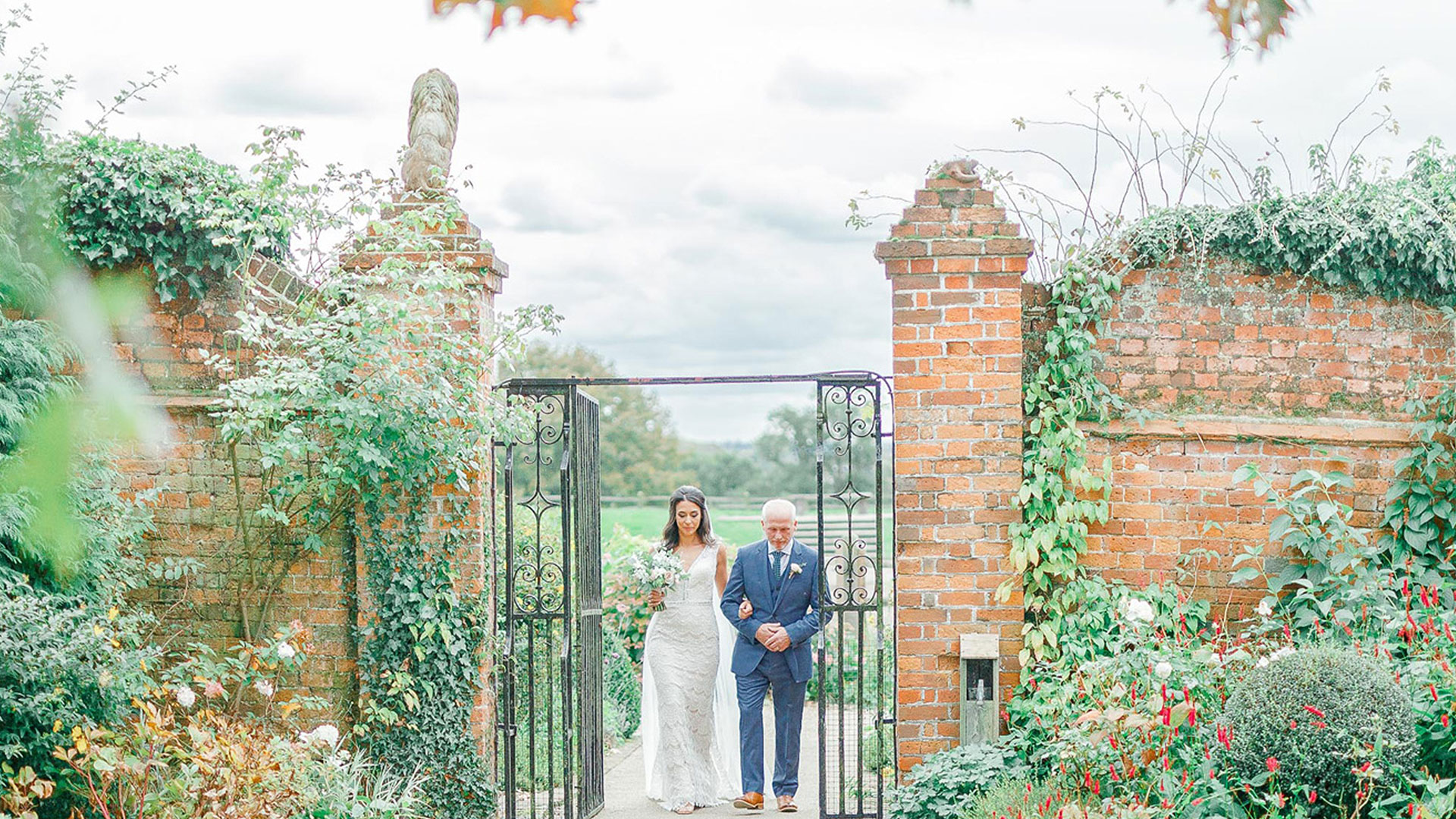 A bride and her father make their way down the Long Walk wedding aisle - wedding venues in Essex
