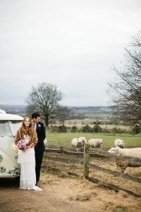 A bride and groom take in the countryside setting for a romantic winter wedding