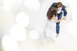 A bride and groom take to the white dancefloor to enjoy their first wedding dance - party venues Essex