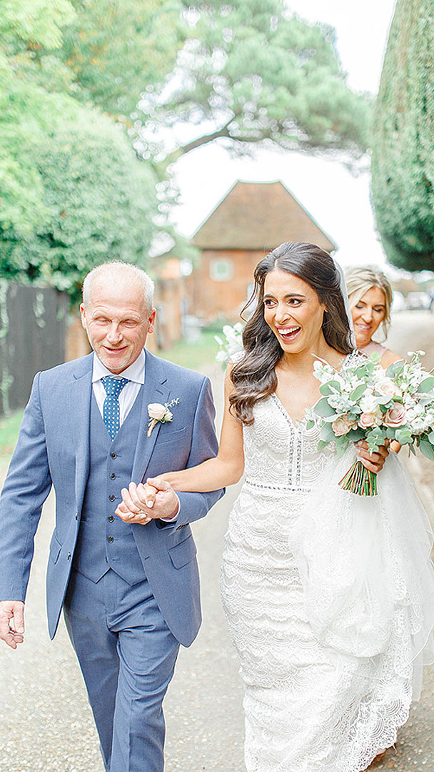 A bride and her father are about to experience a special moment - walking down the wedding aisle