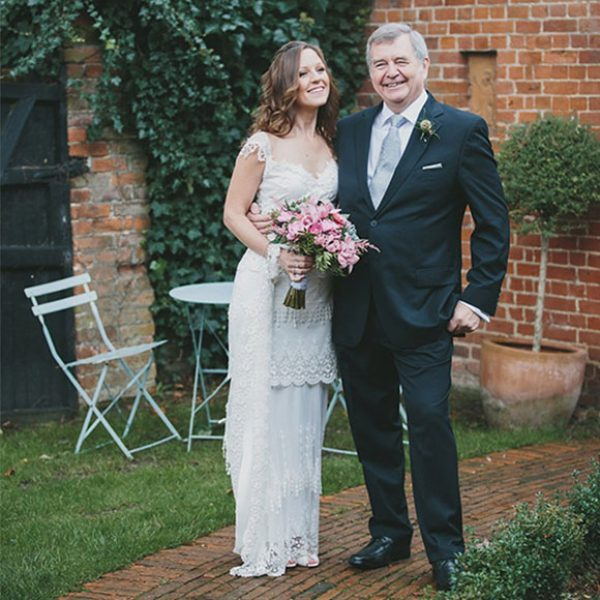 The bride's father standing proud with his daughter before her wedding ceremony at Gaynes Park