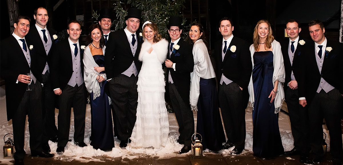 Bridesmaids and groomsmen with bride and groom.