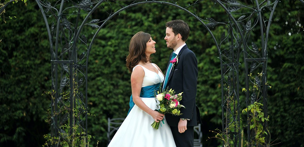 Bride and groom in the gardens at Gaynes Park for photos